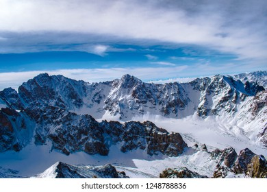mountains under clouds