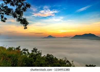 mountains under mist in the morning with sunrise at Phutoke Loei Thailand.