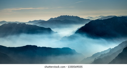 mountains with valley floor shrouded in mist