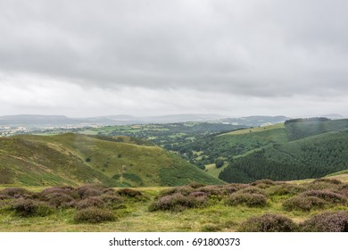 The mountains and valleys at longmynd hills shropshire with a stormy sky.