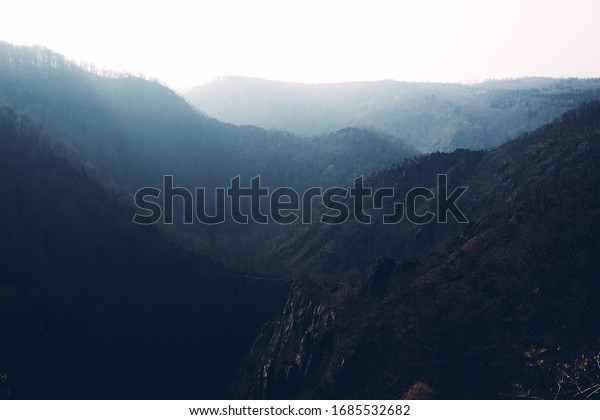 Mountains and valleys are sinking in the mist. Landscapes of the Harz national Park, Germany