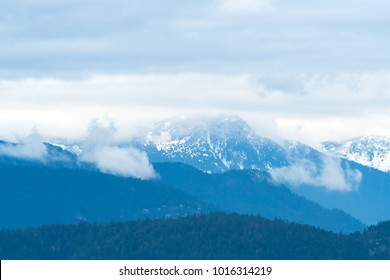 mountains in Vancouver, British Columbia as a background with dramatic sky and clouds