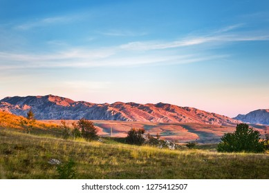 Mountains view with hills and colors sky, colors mountains and mountains background, Durmitor on the way to Black Lake - Crno Lake, from Zhablyak, beauty sunset
