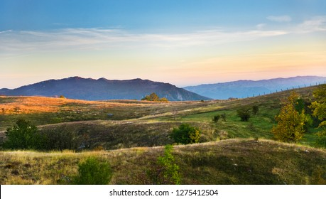 Mountains view with hills and pastel colors sky and mountains background, Durmitor on the way to Black Lake - Crno Lake, from Zhablyak, beauty sunset orange colors