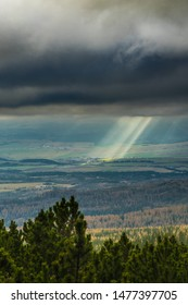 Mountains view, sun rays goues from the cloudy ski. National park High Tatry, Slovakia.