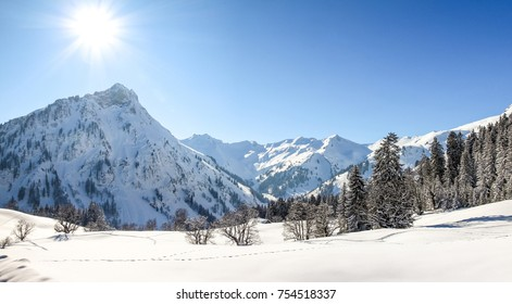 Mountains winter landscape with deep snow on clear sunny day. Allgau, Bavaria, Germany.