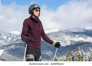 Mountain-skier in a glasses and a helmet in the mountains, a mountain landscape