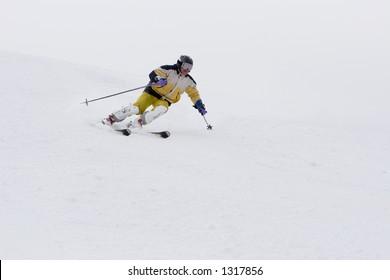 Mountain-skier sliding on the slope