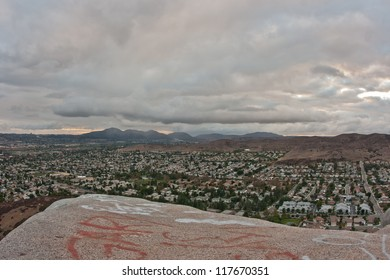 Mountaintop view of suburban San Diego County from atop a big boulder in the afternoon.