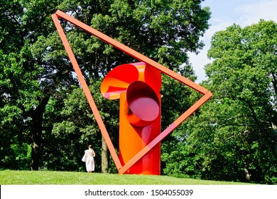 "Mountainville, New York/United States-7/7/2019: beautiful view of red steel sculpture of ""Adam"" by Alexander Liberman and tourist"