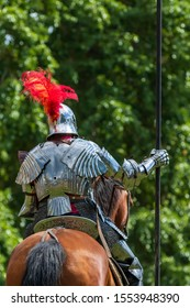 A mounted knight in shining armor readies his lance in preparation for combat in Turku, Finland.