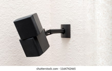 Mounted wall speaker with focus on wall and bracket to show clean wall mount installation