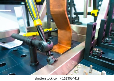 Mounting clip on the workbench. Clamp for connecting metal parts for easy welding. Equipment Assembly production. The clamp helps to fix the parts on the Assembly table.
