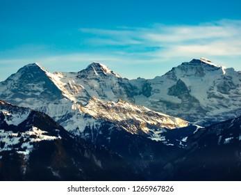 Mounts Eiger, Moench and Jungfrau in the Jungfrau region - Switzerland