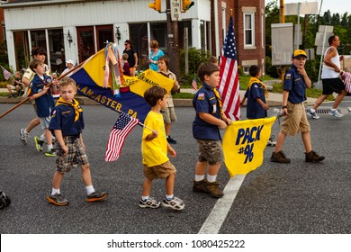 Mountville, PA, USA - May 30, 2012:  At the old-fashioned, small town America parade, local Boy Scouts participate in the Memorial Day observance.