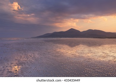 The Mourne Mountains in Northern Ireland at sunset, photographed from Murlough Beach.