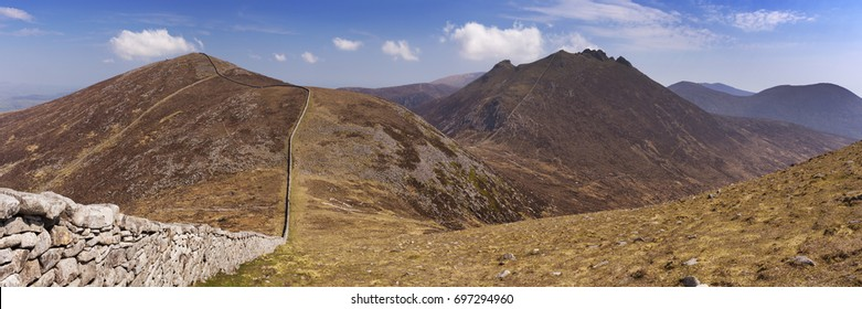 The Mourne Wall and the peaks of Slieve Meelmore and Slieve Bearnagh in the Mourne Mountains in Northern Ireland.