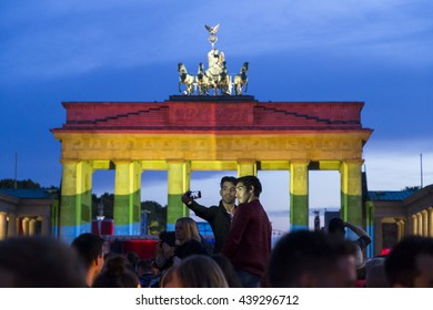 Mourners gathered to commemorate the victims of the massacre of Orlando in front of Brandenburg Gate enlightened with the LGBT rainbow colours in Berlin, Germany on June 16,2016.