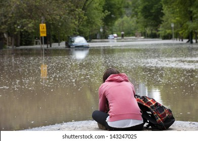 Mournful Calgary Resident Hopelessly Viewing Her Flooded Home and Vehicle; Calgary Flood 2013