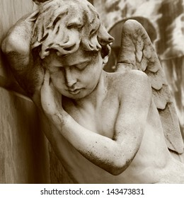 Mourning angel on Recoleta cemetery in Buenos Aires.
