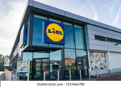 Mouscron,Belgium-February 17,2019: View of Lidl supermarket and logo.Lidl Stiftung & Co. KG  is a German global discount supermarket chain,operating in 26 European countries and the United States.