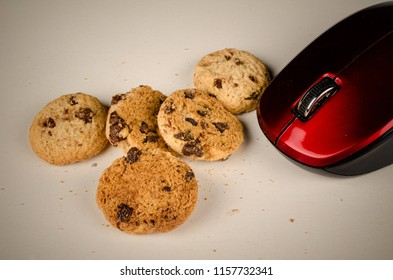 Mouse eating cookies, a funny technology concept