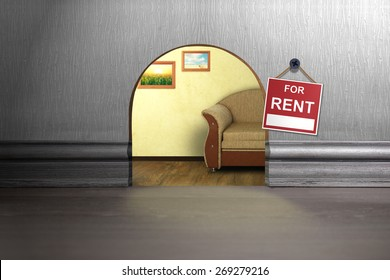 Mouse hole in wall with sign for rent. House rent concept