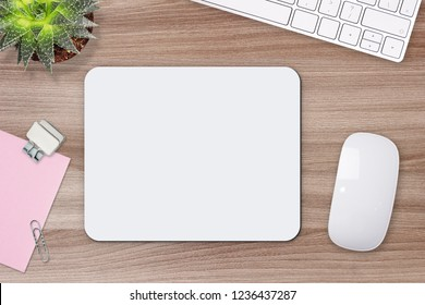 Mouse pad mockup. White mat on the table with props.