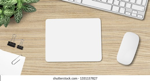 Mouse pad mockup. White mat on the table with props.          - Image