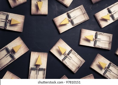 mouse traps with cheese pointing towards an empty space