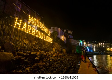 Mousehole, Cornwall, UK. 12/15/2018. Editorial: Members of the public. A small fishing to located at the end of cornwalls peninsula that hosts an iconic, annual & popular Christmas light display.