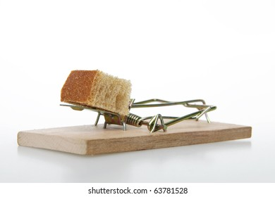 Mousetrap with bait, on white background.