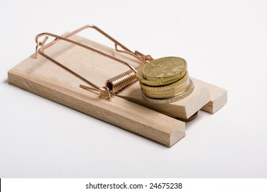 A Mousetrap with Euro coins as bait. Isolated on white. Studio shot.