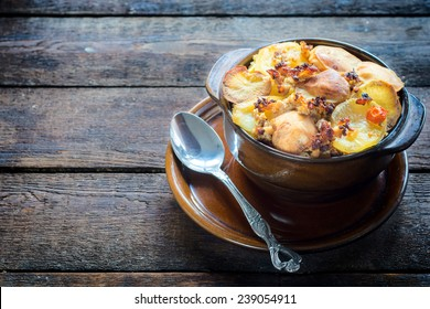 Moussaka in the old brown bowl with baked potato on top,selective focus and blank space