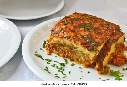 Moussaka on white dish. Greek cuisine menu.