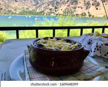 Moussaka is the traditional food of Greeks, use the chance to taste it on the summer terrace of a nice greek restaurant with its beautiful view to Kournas lake