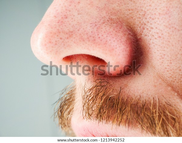 Moustache on caucasian man at close up, shallow depth of field