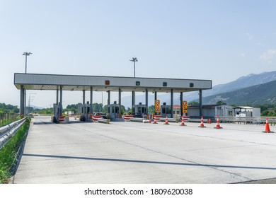 Moustheni, Greece - September 01 2020: Highway toll stations with fee collecting booths. Greek roadway where car drivers pay to pass gates for Egnatia Motorway sections, with e-pass option.