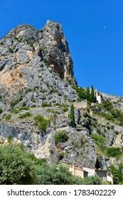 Moustiers-Sainte-Marie and Notre-Dame-de-Beavoir chapel in the mountain. Moustiers-Sainte-Marie is a commune in the Alpes-de-Haute-Provence department in southeastern France