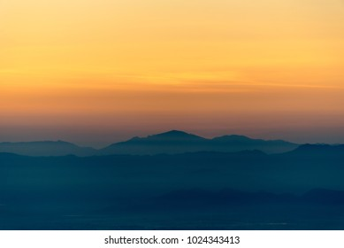 Moutain range and mist at sunrise.