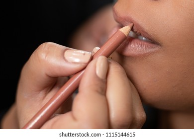 Mouth being made lip contour with nude pencil