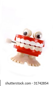 Mouth full of teeth windup toy