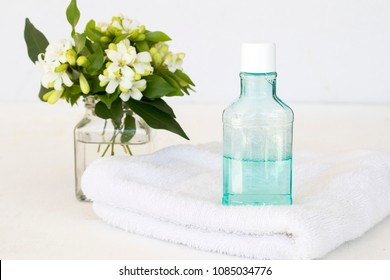 mouthwash and bath towel for healthy care oral cavity from nature on white