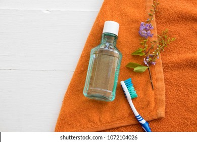 mouthwash and toothbrush for healthy care oral cavity with bath towel on background white