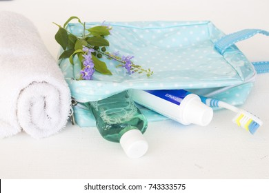 mouthwash and toothbrush for healthy care oral cavity in bag for journey