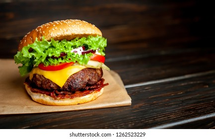 mouth-watering delicious homemade burger used to chop beef on the wooden table