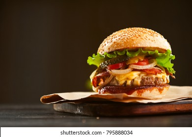 mouth-watering delicious homemade burger used to chop beef on the wooden table.