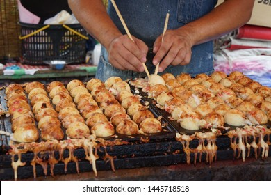 Move the hand of the street food chef to Takoyaki. Takoyaki is one of the names of Japanese food which is round dumplings made from flour, milk, squid and eggs mixed together.