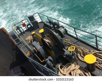 MOVEABLE ROPE PULLY ON SIDE OF FERRY BOAT SHIP , OCEAN BACKGROUND
