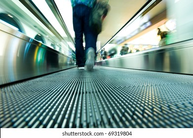 movement of abstract escalator with people